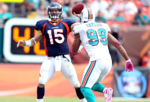 Tebow led the Broncos to an 18-15 OT win against the Miami Dolphins Oct. 23 (Photo by Marc Serota/Getty Images)