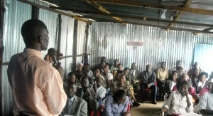 Pastor Emmanuel preaching at the Life in Christ Church in Kibera in 2009