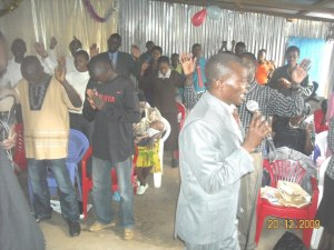 Members of the Life in Christ Church of Kibera praying