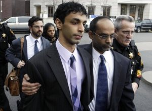 Dharun Ravi escorted by his father as they leave court on March 16 (Mel Evans/AP)