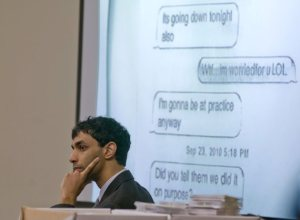 Ravi listens to testimony by Molly Wei with text messages between them displayed on a screen. (Mark Dye/Reuters)