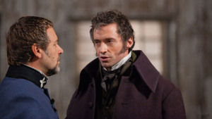 Javert explains his mistaken suspicion to the mayor (Valjean)
